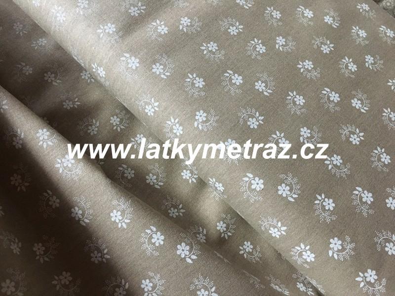 květinka bílá na béžové